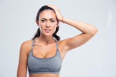 Portrait of a sports woman having headache Royalty Free Stock Photography