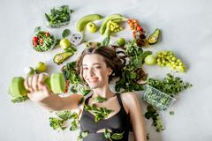 Portrait of a sports woman with healthy food stock photos