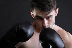 Portrait sportsman boxer in studio dark background Royalty Free Stock Photos
