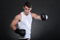 Portrait sportsman boxer in studio dark background Stock Photography