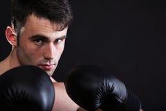 Portrait sportsman boxer in studio dark background Stock Photos