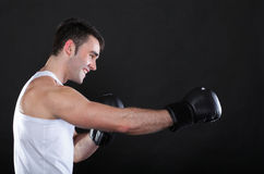 Portrait sportsman boxer in studio dark background Royalty Free Stock Image