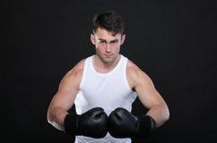Portrait sportsman boxer in studio dark background Stock Image