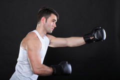 Portrait sportsman boxer in studio dark background Stock Photo
