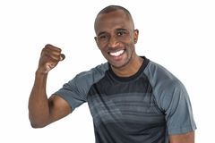 Portrait of sportsman cheering after success in rugby Royalty Free Stock Image