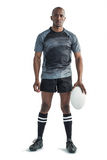 Portrait of sportsman holding rugby ball while standing Royalty Free Stock Photos