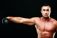 Portrait of a sportsman lifting dumbbell Royalty Free Stock Photos