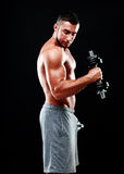 Portrait of a sportsman lifting dumbbells Stock Image