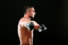 Portrait of a sportsman lifting dumbbells Stock Images