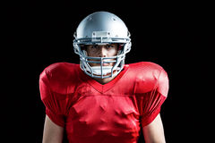Portrait of sportsman playing American football Stock Photos