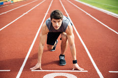 Portrait of the sportsman ready to run Royalty Free Stock Image