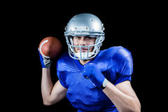Portrait of sportsman smiling while throwing ball Royalty Free Stock Photography