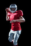Portrait of sportsman throwing American football Stock Photography