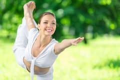Portrait of sportswoman exercising in park Stock Photo