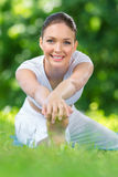 Portrait of sportswoman stretching in park Royalty Free Stock Photography