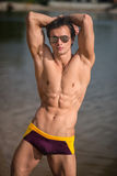 Portrait of a sporty, athletic, muscular sexy man in swimtrunks Stock Photos