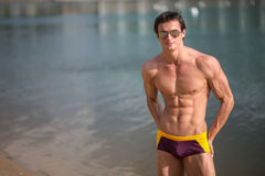 Portrait of a sporty, athletic, muscular sexy man in swimtrunks Royalty Free Stock Images