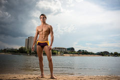 Portrait of a sporty, athletic, muscular sexy man in swimtrunks Royalty Free Stock Photography