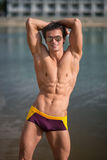 Portrait of a sporty, athletic, muscular sexy man in swimtrunks Stock Photography