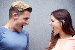 Portrait of sporty couple screaming at each other. Portrait of sporty young couple screaming at each other Royalty Free Stock Photography