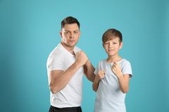 Portrait of sporty dad and his son stock photography
