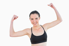 Portrait of sporty fit young woman clenching fists Royalty Free Stock Photos