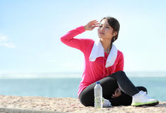 Portrait of sporty girl protect the face from sunburn Royalty Free Stock Photos