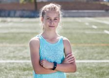 Portrait of sporty girl standing on sports field Stock Photo