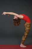 Portrait of sporty, healthy, young girl doing yoga exercises,work out, studio shot Royalty Free Stock Photography