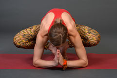 Portrait of sporty, healthy, young girl doing yoga exercises,work out, studio shot Royalty Free Stock Images