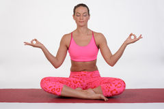 Portrait of sporty, healthy, young girl doing yoga exercises,work out, studio shot Stock Photos