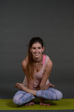 Portrait of sporty, healthy, young girl doing yoga exercises,work out, studio shot Royalty Free Stock Photos