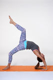 Portrait of sporty, healthy, young girl doing yoga exercises,work out, studio shot Stock Images