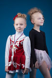 Portrait of sporty little girls posing in studio Royalty Free Stock Images