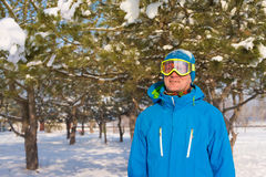 Portrait of sporty man who is wearing winter jacket and ski gogg Stock Photos