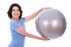 Portrait of sporty mature woman with fitness ball isolated on wh Stock Photography