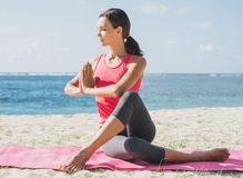 Sporty woman doing stretching yoga exercise Stock Images