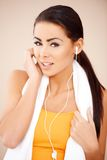Portrait of sporty woman wearing headphones Stock Photography