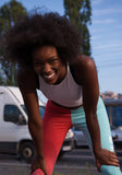 Portrait of sporty young african american woman running outdoors Stock Photos