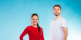 Portrait of sporty young couple on blue Stock Photos