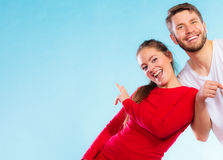 Portrait of sporty young couple on blue Royalty Free Stock Photo
