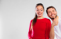 Portrait of sporty young couple on blue Stock Photo