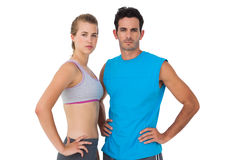 Portrait of a sporty young couple with hands on hips Royalty Free Stock Image
