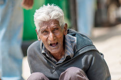 Portrait of Sri Lankan old poor musician on the street Royalty Free Stock Photo