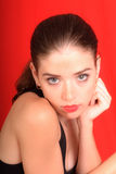 Portrait of Stacey. Portrait of beautiful young woman on red background royalty free stock images
