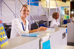 Portrait Of Staff At Airport Check In Desk Stock Image