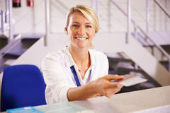 Portrait Of Staff At Airport Check In Desk Royalty Free Stock Image