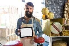 Portrait of staff showing digital tablet at counter Stock Photography