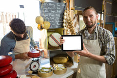 Portrait of staff showing digital tablet at counter Stock Images