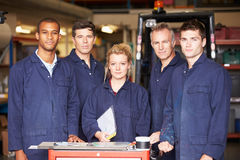 Portrait Of Staff Standing In Engineering Factory. Looking To Camera royalty free stock photography